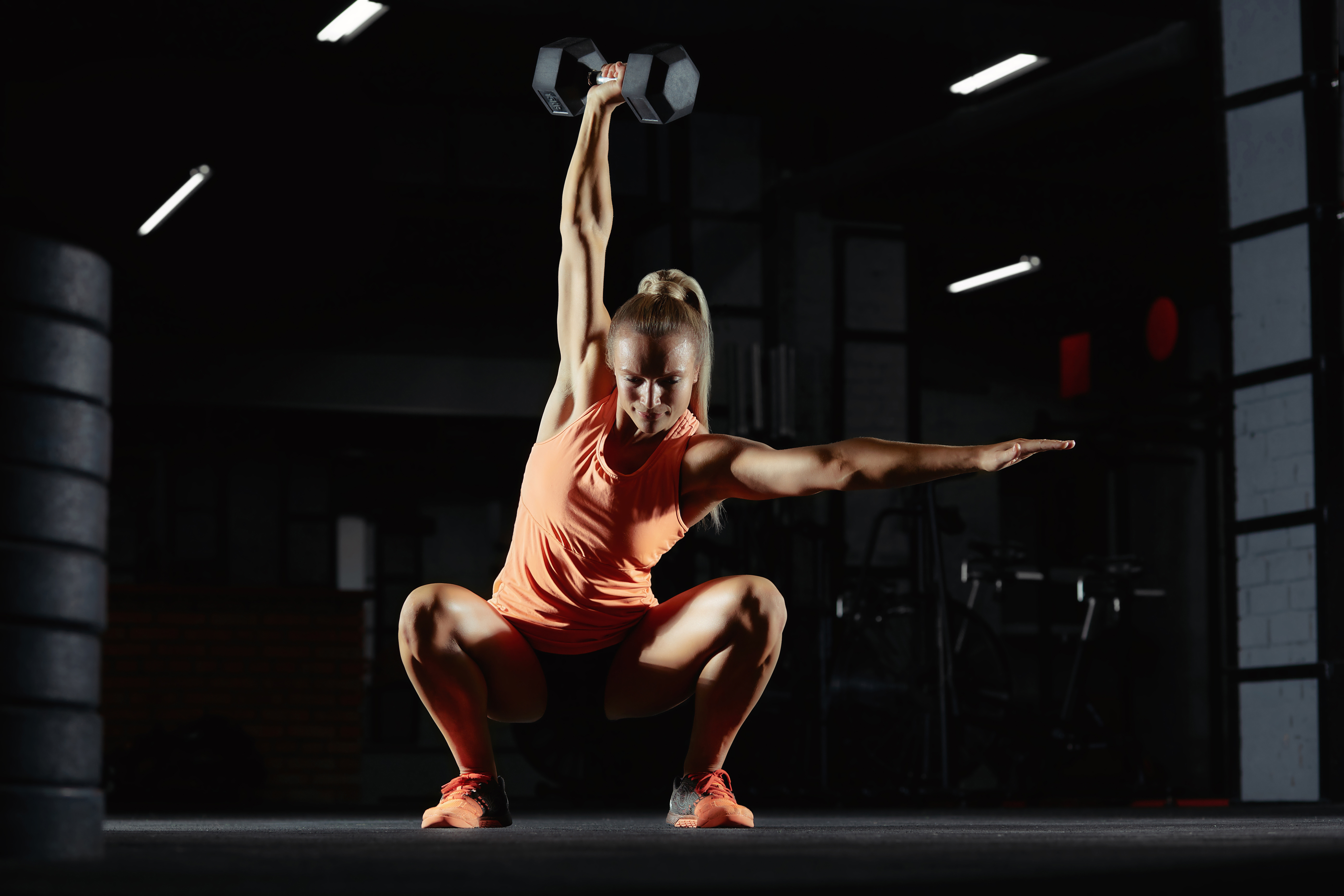 Beautiful sportswoman exercising at the gym doing overhead kettlebell squats copyspace motivation beauty confidence fitness athletic body feminine powerful muscles weight gain concept